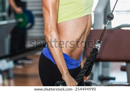 beautiful athletic sporty confident  young girl working out in gym - stock photo