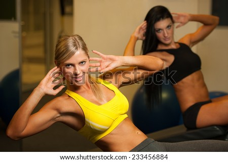 beautiful athletic woman working ab intervals - stock photo