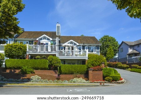 Beautiful attached houses with asphalt road around. British Columbia, Canada. - stock photo