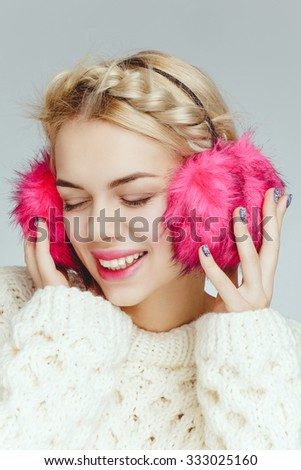 Beautiful attractive charming young blonde model with pink headphones listen to music. Nude daily fresh natural makeup. - stock photo