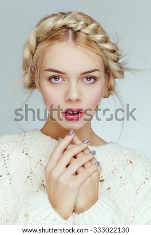 Beautiful attractive charming young model posing in studio. Nude daily natural makeup, blonde hair, beauty portrait closeup. - stock photo