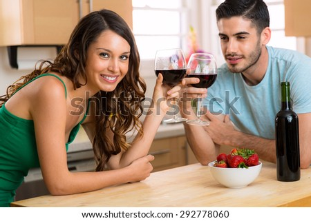 Beautiful attractive couple of lovers share and drink wine on a date at home - stock photo