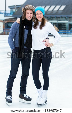 Beautiful, attractive couple on the ice rink