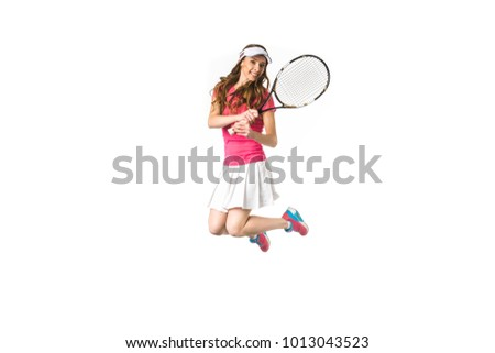 beautiful attractive girl playing tennis and jumping isolated on white