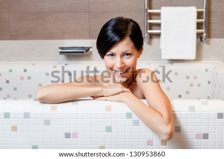 Beautiful attractive girl relaxes in bath, hygiene concept - stock photo