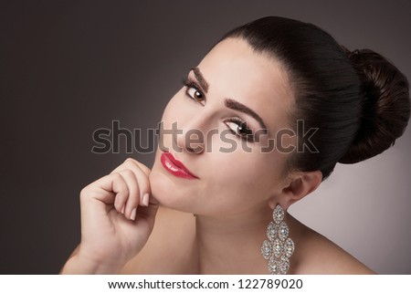 Beautiful attractive pretty young woman face closeup - stock photo