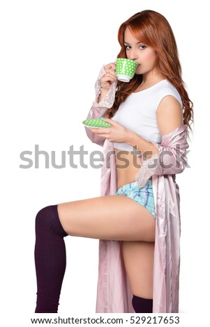 beautiful attractive redhead girl holding drinking cup of tea, coffee. drinking coffe. isolated on white