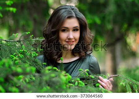 Beautiful,attractive,smiling,cute,lovely,kind,awesome,gorgeous,excellent girl,model in the fresh,green,spring garden,park,forest.Spring time.Portrait of beautiful girl in spring,green blossom garden. - stock photo