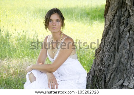 Beautiful attractive woman in a meadow - stock photo