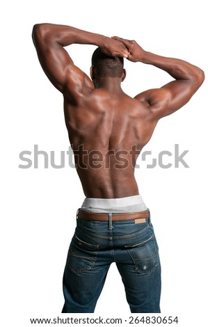 Beautiful attractive young fit muscular man standing - stock photo