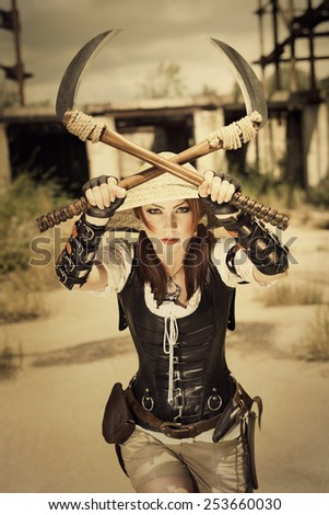 Beautiful attrctive agressive female warrior holding two swords and fighting - stock photo