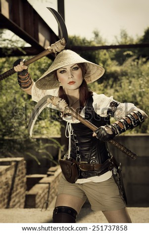 Beautiful attrctive female warrior holding two swords and fighting - stock photo