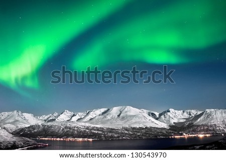 Beautiful Aurora above fjords near Skibotn, Norway - stock photo