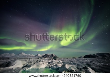 Beautiful Aurora Borealis - Spitsbergen, Svalbard - stock photo