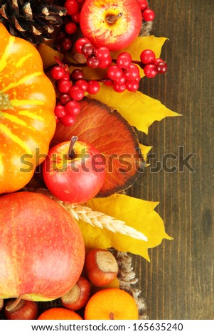 Beautiful autumn composition, on wooden background