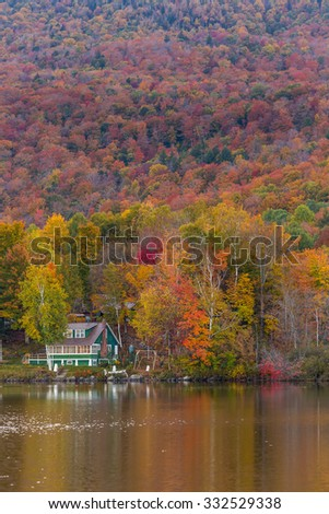 Beautiful autumn foliage and cabin in Elmore state park, Vermont. - stock photo