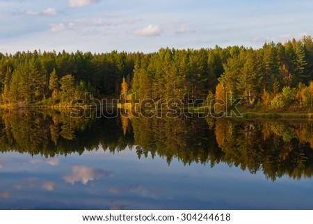 Beautiful autumn forest at the rivers coast. Karelia. - stock photo