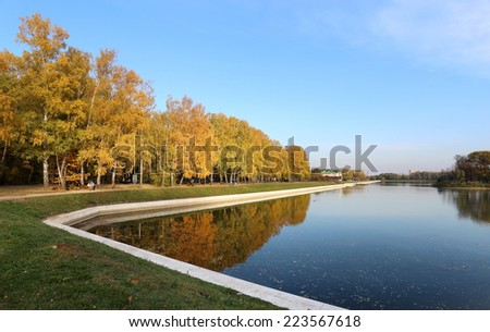 beautiful autumn landscape with trees and ponds, sunny day   - stock photo