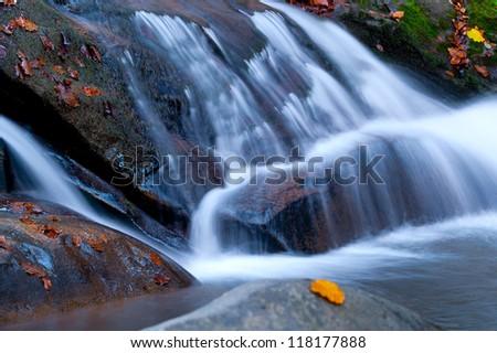 beautiful autumn mountain stream with the waterfall - stock photo