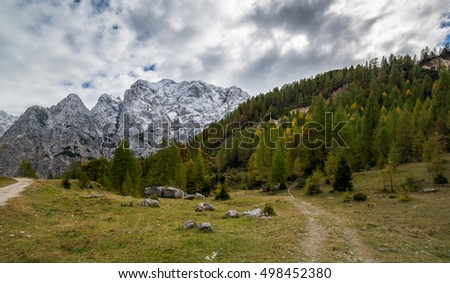 Beautiful autumn scenery in mountains with first snow in the Julian Alps.