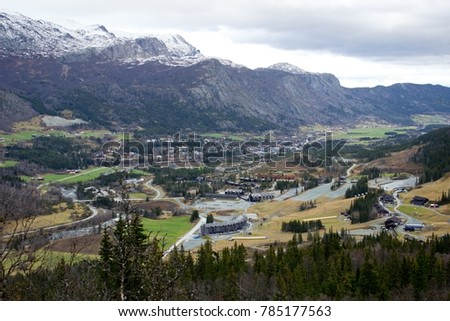 Beautiful autumn view on norwegian mountains and village in valley