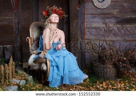 Beautiful autumn woman in a blue dress - stock photo