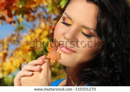 Beautiful Autumn Woman outdoors portrait. Soft sunny colors. - stock photo