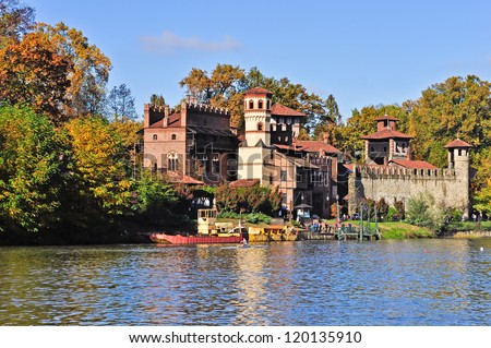 Beautiful autumnal view of medieval village in Valentino's park, Turin. Italy. - stock photo