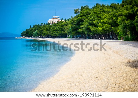 Beautiful azure blue Mediterranean beach surrounded by green trees in Croatia - stock photo
