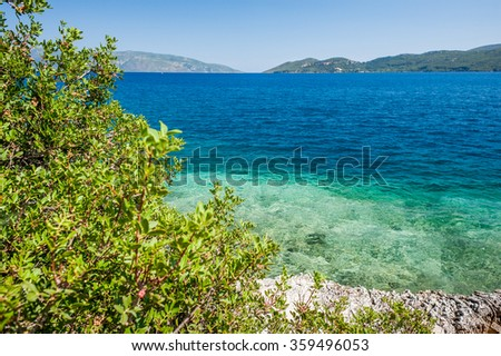 Beautiful azure mediterranean seaside landscape with hills and clear blue sky