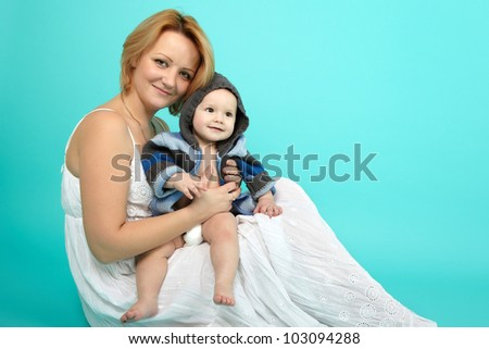 Beautiful baby and happy mother - stock photo