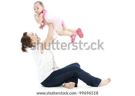 Beautiful baby and her mother - stock photo