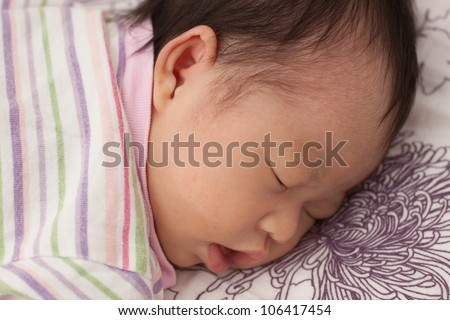 Beautiful Baby Asian Infant Girl Sleeping in Prone position - stock photo