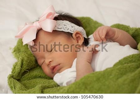 Beautiful Baby Asian Infant Girl Sleeping on Green Blanket - stock photo