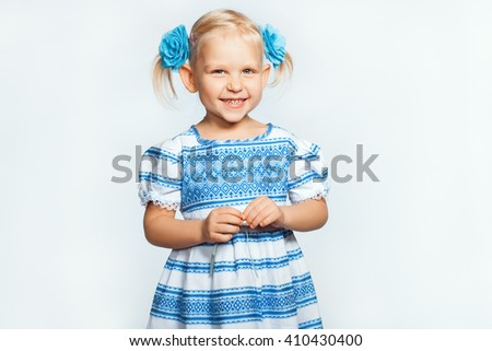 Beautiful baby blonde girl  on a white background smiling - stock photo