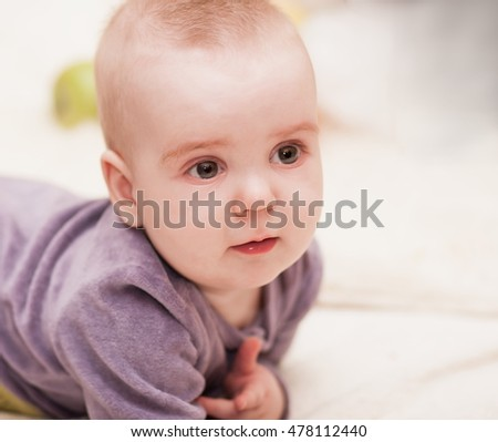 Beautiful baby boy, has brown eyes, sad face, clean skin. White background. Kids space. Close up. Happy childhood.