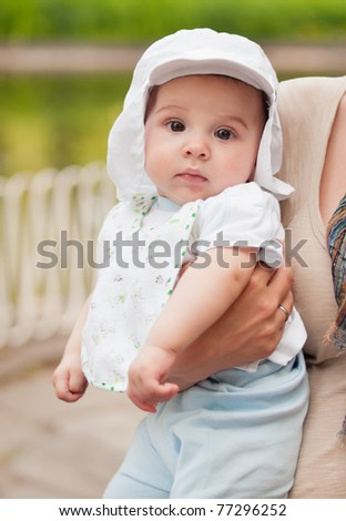 Beautiful baby boy portrait outdoors - stock photo
