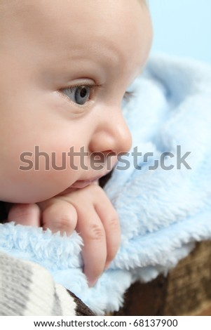 Beautiful baby boy staring into the distance - stock photo