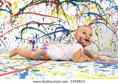Beautiful baby covered in bright paint