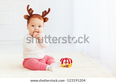 beautiful baby deer playing with toy at home