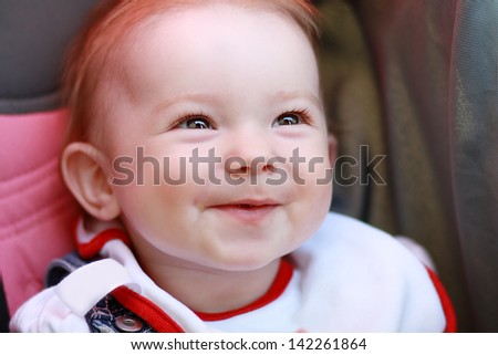 Beautiful baby few months old with charming smile outdoors - stock photo