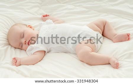 Beautiful baby girl asleep on a blanket.Sleeping baby. - stock photo