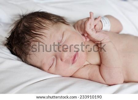 Beautiful baby girl newborn in the hospital - stock photo