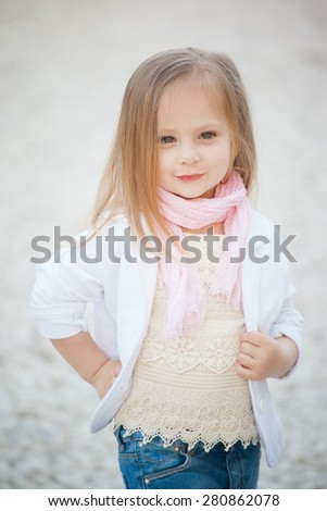 beautiful baby girl with blonde  hair outdoors. Little girl 2-3 year old