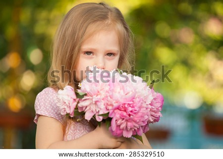 beautiful baby girl with pink flowers outdoors. Little girl 2-3 year old - stock photo