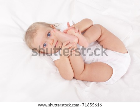 Beautiful baby in bed