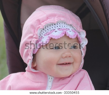 Beautiful baby in carriage - stock photo