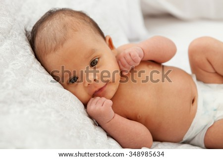 Beautiful baby in diaper with open eyed - stock photo