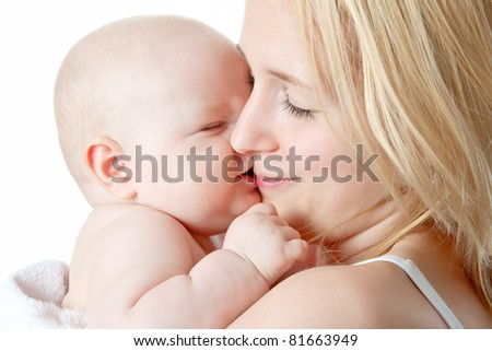 Beautiful baby in mothers hands