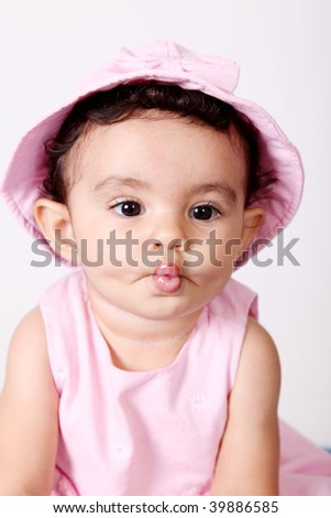 Beautiful baby making gestures with his mouth. Tender  Image - stock photo